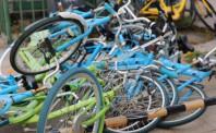 因乱停乱放  四家共享单车企业被罚款