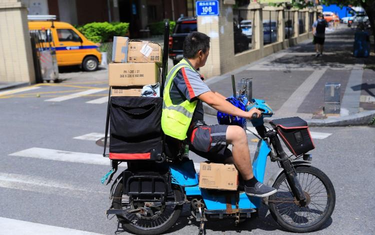国家邮政局:6月快递业务量超过54亿件 增速近30%_物流